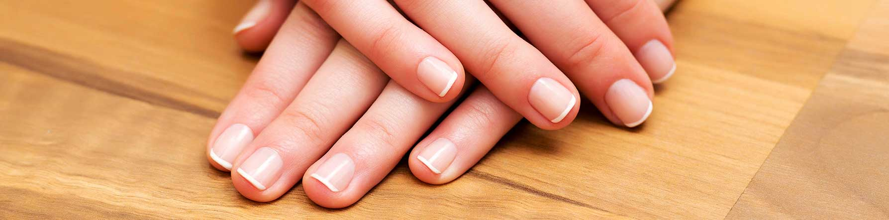 hands with French tip manicure
