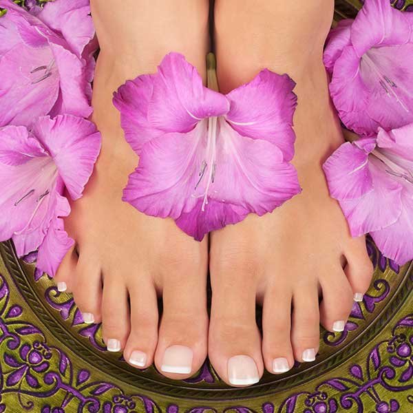 French tip pedicure with purple roses